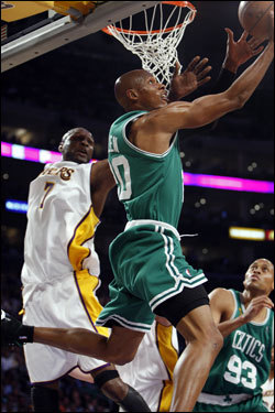 Ray Allen (20) drove to the basket during the first half.