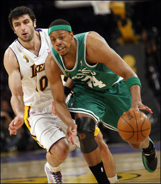 Vladimir Radmonovic (left) chased Paul Pierce (right) during the first half.