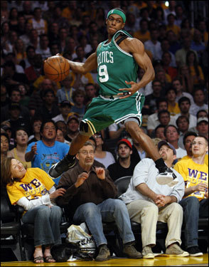 Celtics point guard Rajon Rondo jumped to save the ball during first half action.