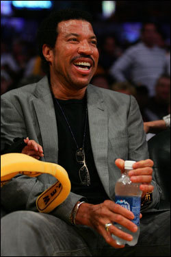 Singer Lionel Richie watched the game from courtside.
