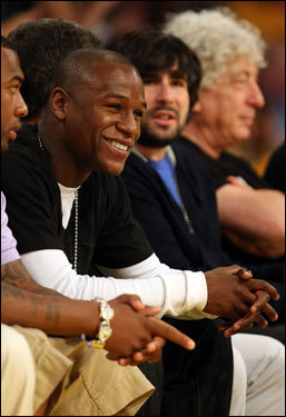 Recently retired boxer Floyd Mayweather Jr. watched the action in the first half.