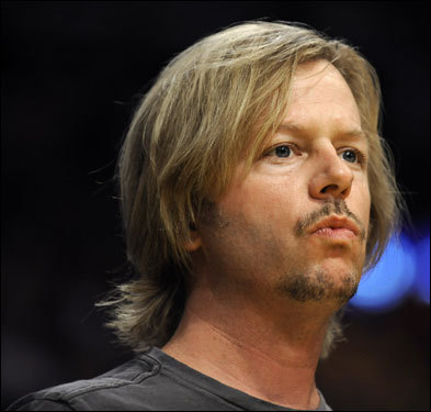 Actor David Spade looked on during the game.