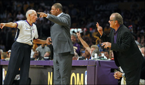 Referee Dick Bavetta (left) talked with Celtics head coach Doc Rivers (center) while Jack Nicholson chimed in from the sidelines.