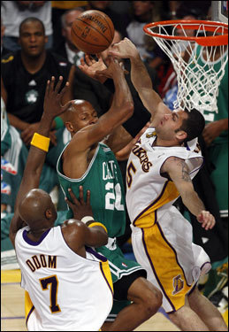 Ray Allen (center) was blocked by the Lakers' Jordan Farmar (right) during the game.