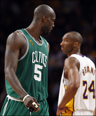 Kevin Garnett (left) looked back at Kobe Bryant (right) during a break in the action.