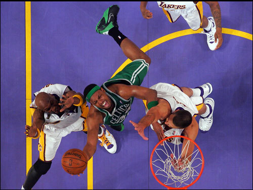 Paul Pierce (center) laid in a bucket between two Lakers.