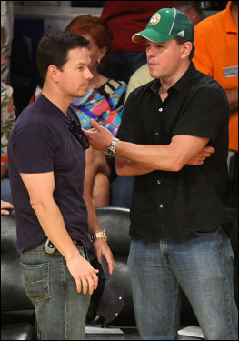 Matt Damon (right) and Mark Wahlberg (left) talked during Game 5.