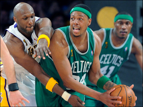 Lamar Odom (left) defended Paul Pierce (right) during the game.