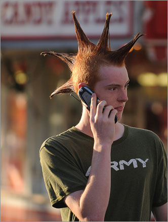 While sporting a mohawk CJ Doherty, 16, of Kingston talks on the phone as he hangs out with friends on a Friday afternoon at the Hanover Dare Carnival at Hanover Mall on June 13, 2008.
