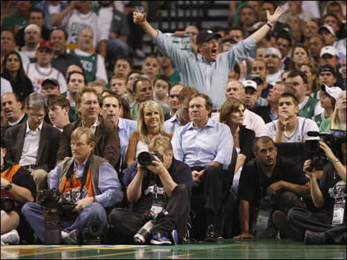 Red Sox owner John Henry (left) sat a few seats down from Bill Belichick (right) and his girlfriend Linda Holliday (center).