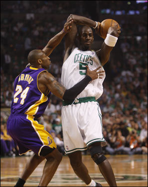 Lakers guard Kobe Bryant (left) defended Kevin Garnett (right) during the first quarter.