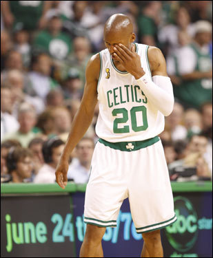 Celtics guard Ray Allen reacted after being poked in the eye in the first quarter.