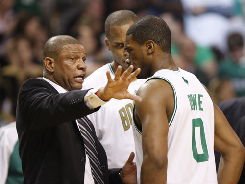 Doc Rivers (left) spoke to Celtics forward Leon Powe (right) during a break in the action.