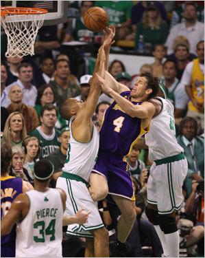 Celtics center P.J. Brown (left) defended a shot from Luke Walton (center).