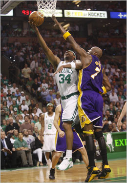 Paul Pierce (left) drove to the basket against Lamar Odom (right) during the first half.