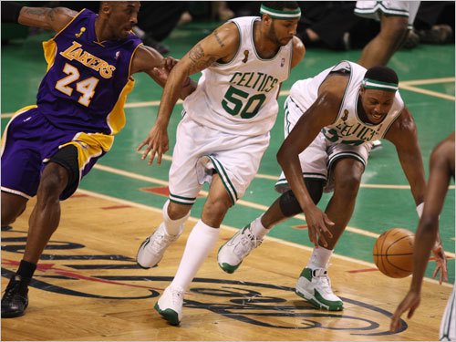 Paul Pierce (right) picked up a loose ball as Eddie House (center) and Kobe Bryant (left) looked on.