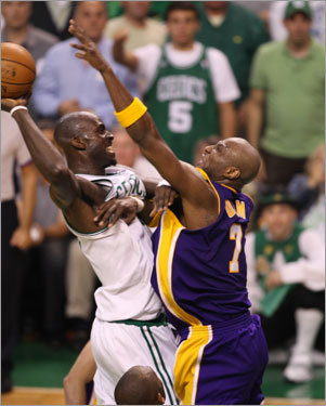 Kevin Garnett (left) was fouled by Lamar Odom but still managed to make the shot during the second quarter.