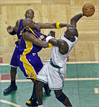 Kevin Garnett (right) looked to shoot after being fouled by Lamar Odom (left) during the second quarter.