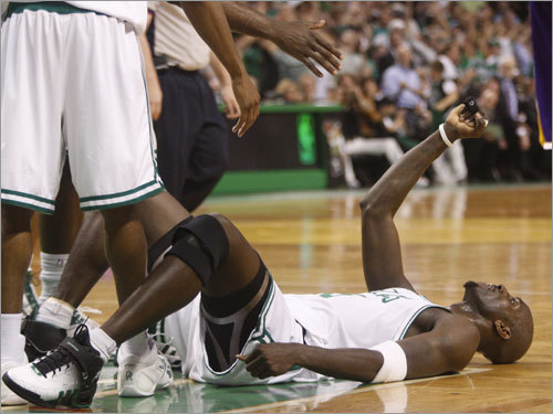 Kevin Garnett was helped up by teammates after scoring and being fouled in the second quarter.