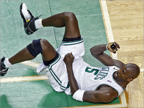 Kevin Garnett celebrated on the parquet floor after making a shot in the second quarter.