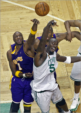 Lamar Odom (left) and Kevin Garnett (right) fought for a jump ball during first-half action.