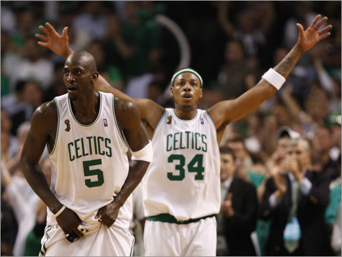 Kevin Garnett (left) and Paul Pierce (right) looked on during the first half.