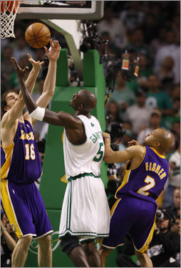 Celtics center Pau Gasol (left) and Kevin Garnett (5) battled for a loose ball during the game.