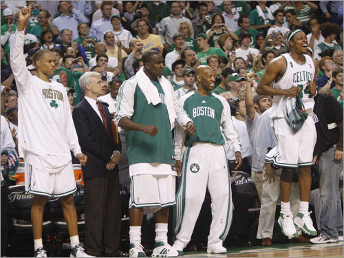 P.J. Brown (left), Paul Pierce (right) and the Celtics bench celebrated late in the game.