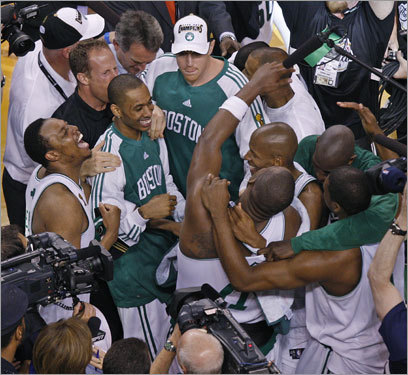 Celtics players embraced after winning the 2008 NBA Championship.