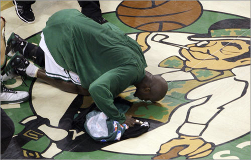 Kevin Garnett kissed the parquet floor after the Celtics won the NBA championship.