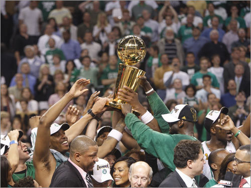 Celtics teammates held up the trophy together during celebrations.