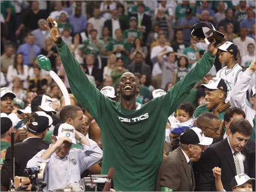 Kevin Garnett (center) and teammates reacted during celebrations.