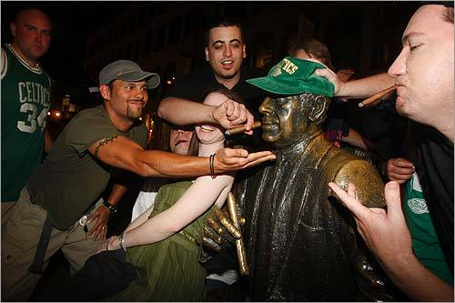 After the Celtics beat the Lakers Tuesday night to win their 17th NBA title, a group of fans stopped by the statue of Celtics legend Red Auerbach for a postgame, celebratory smoke.