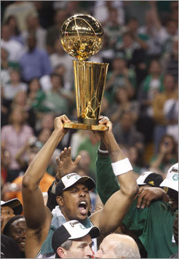 Paul Pierce celebrated with the Larry O'Brien trophy after the Celtics victory.