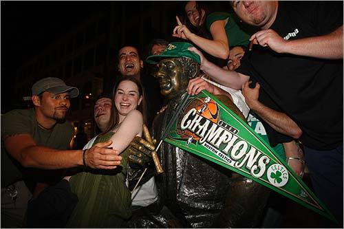 After enjoying a few cigars with Red, fans adorned him with his very own Celtics hat and Celtics NBA Championship pennant.