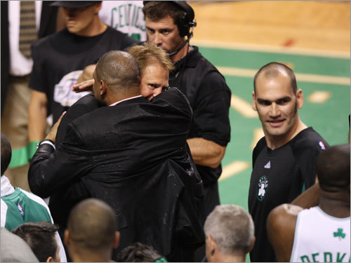Danny Ainge (left) hugged Doc Rivers after the Celtics won the NBA championship.