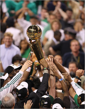 The Celtics held up the Larry O'Brien trophy during celebrations.