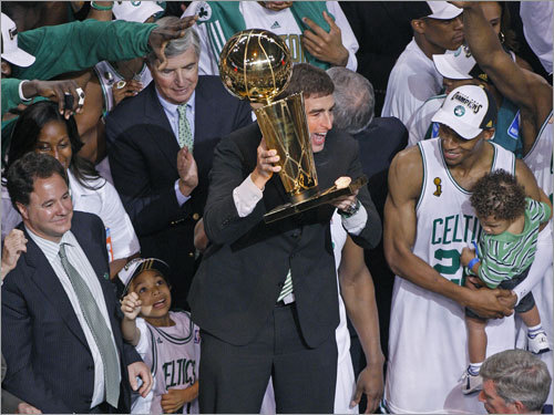 Celtics owner Wyc Grousbeck held the Larry O'Brien trophy during celebrations.