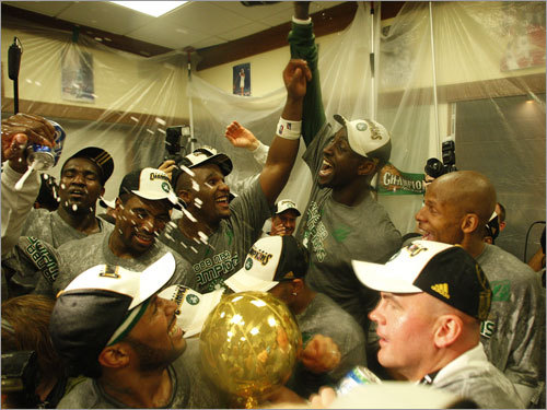 The Boston Celtics celebrated in the locker room after winning the NBA championship.
