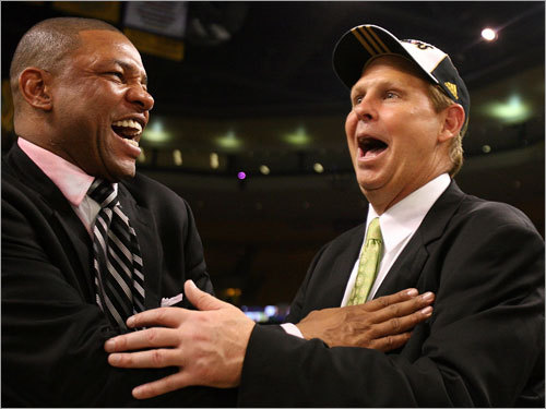 Doc Rivers (left) and Danny Ainge (right) shared a laugh during celebrations.