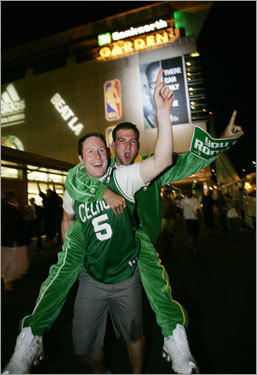 Joe Winsby (5) carried Thomas Aucoin as they celebrated the Celtics' 17th NBA championship.