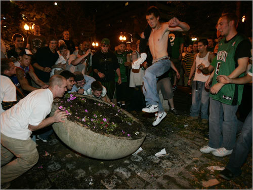 Other rowdy revelers tipped over a cement planter at Faneuil Hall.