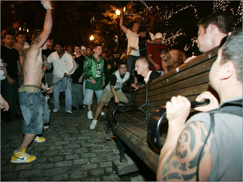 Revelers tipped over a bench at Faneuil Hall.