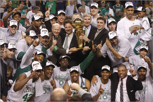 The 2008 Boston Celtics mugged together for a team photo after becoming the NBA's new champions.