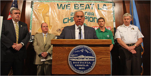 Flanked by various officials, Mayor Menino outlined the route that the parade would take.