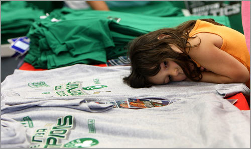 Although she didn't stay up for the game last night, 5 year old Elizabeth of Saugus may be feeling like a lot of Celtics fans after the late win last night. She rests her head on the vast championship merchandise available the morning after the Celtics' NBA Finals victory.