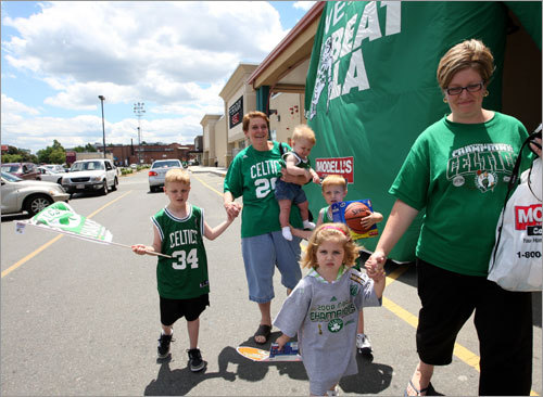 The Dube family of Malden exits Modell's Sporting Goods in Medford, newly purchased merchandise in hand.