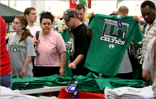 At Modell's in Medford, customers perused the selection of championship merchandise available.
