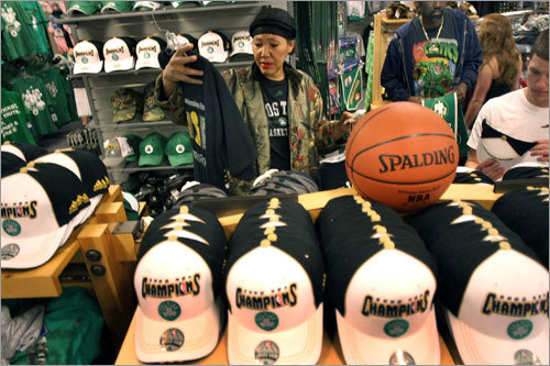 Latanya Bradford, of Dorchester, did some shopping for Celtics T-shirts at the Boston Bruins Pro Shop at North Station.