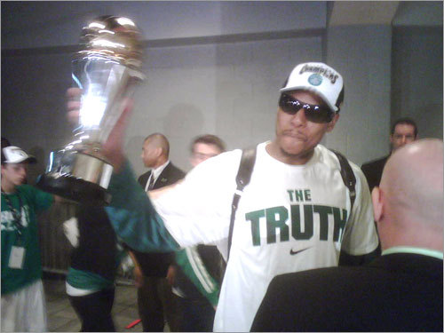 Pierce showed off the Finals MVP trophy as he arrived at the Garden.